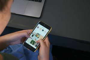 Someone using a social media app on a smartphone.