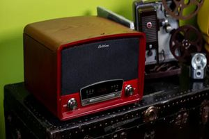 The Electrohome record player sitting on top of a trunk.