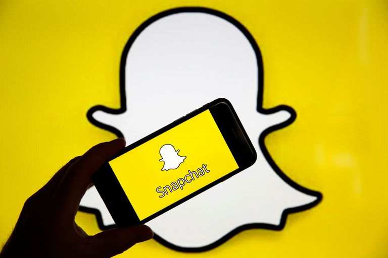 Snapchat logo and icon on phone