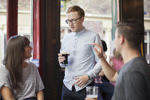 Three friends talking in a pub