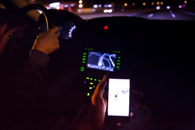 Person holding Android phone in car