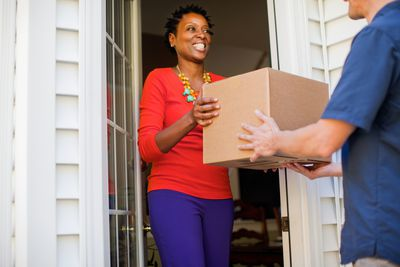 Picture of a woman receiving a package at her door