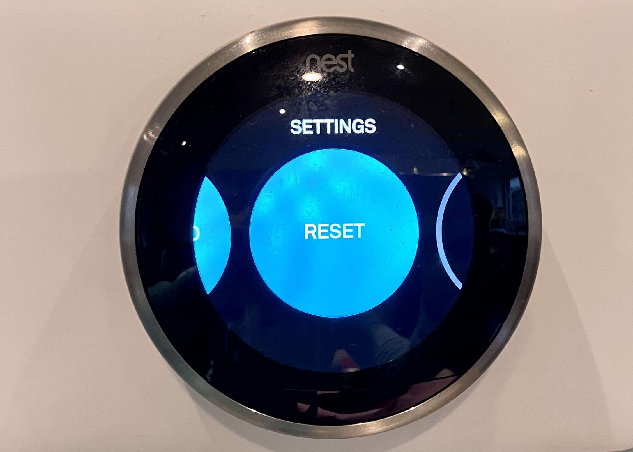 The menu on the Nest thermostat showing Reset.