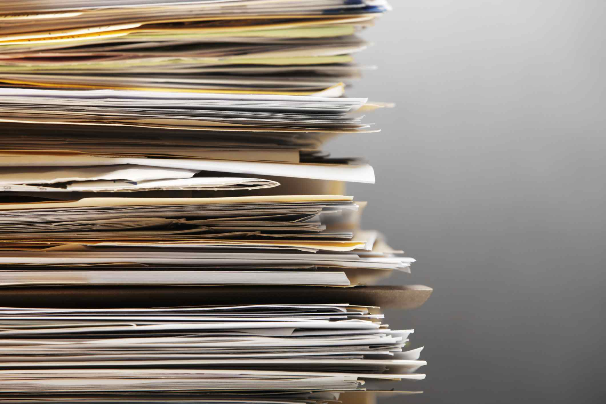 Photo of a stack of files and paper