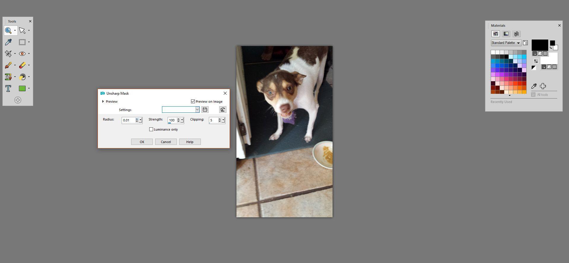 PaintShop Pro with Unsharp Mask options showing.