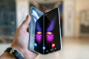 person holding the Samsung Galaxy Fold