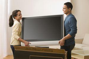 Couple unboxing TV