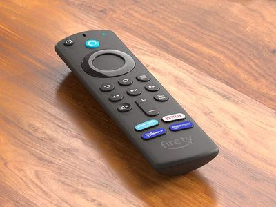 An All-new Amazon Fire TV Stick 4K remote with a Disney Plus button sitting on a wooden table.