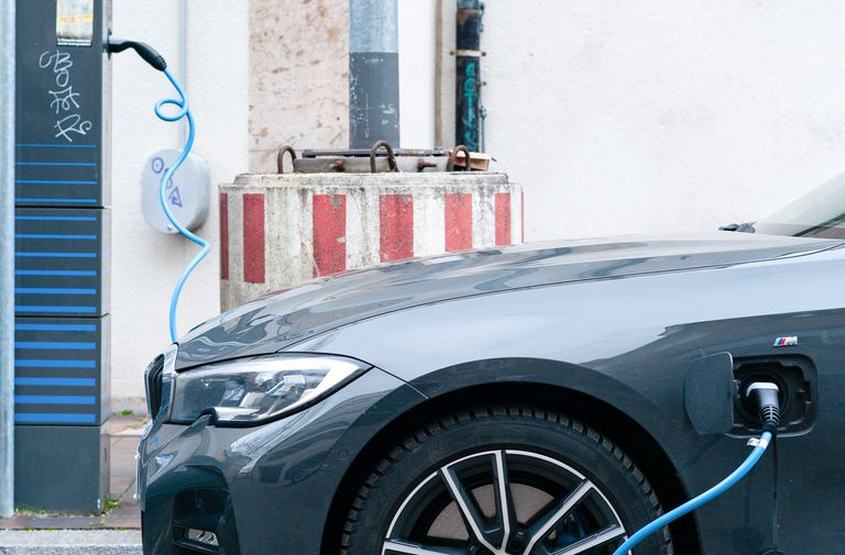An electric vehicle being charged at a public charging station