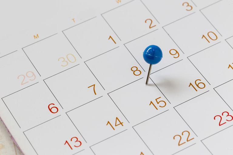 Close-Up Of Thumbtack On Calendar Date