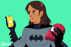 Cosplayer in a Batman costume holding a Spider-Man mask and a Snapchat app on a phone