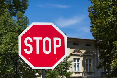 STOP-sign with facade in the background