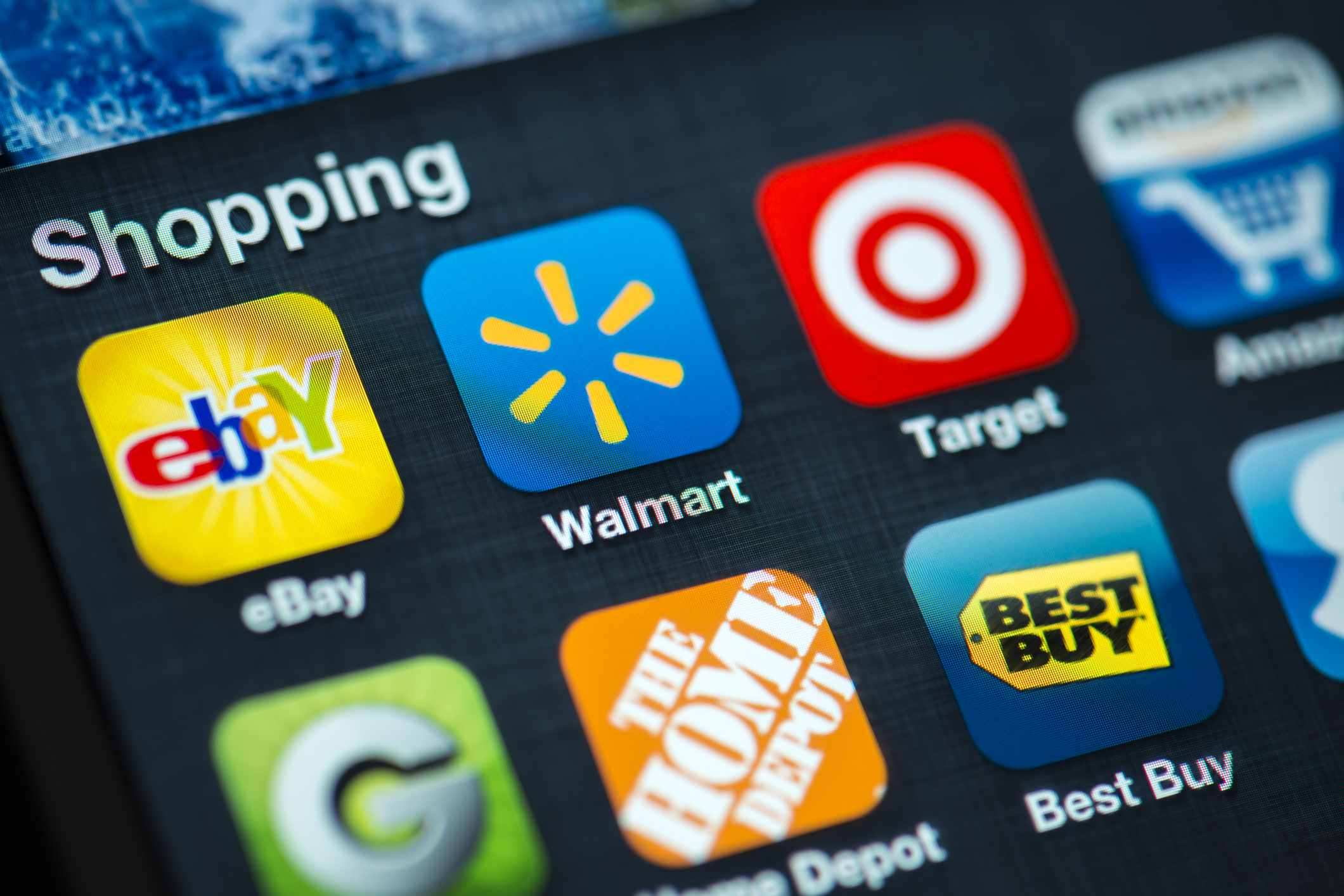 An image of a smartphone showing the Walmart app on its screen.