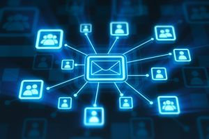 digital glowing blue envelope pointing to email contacts