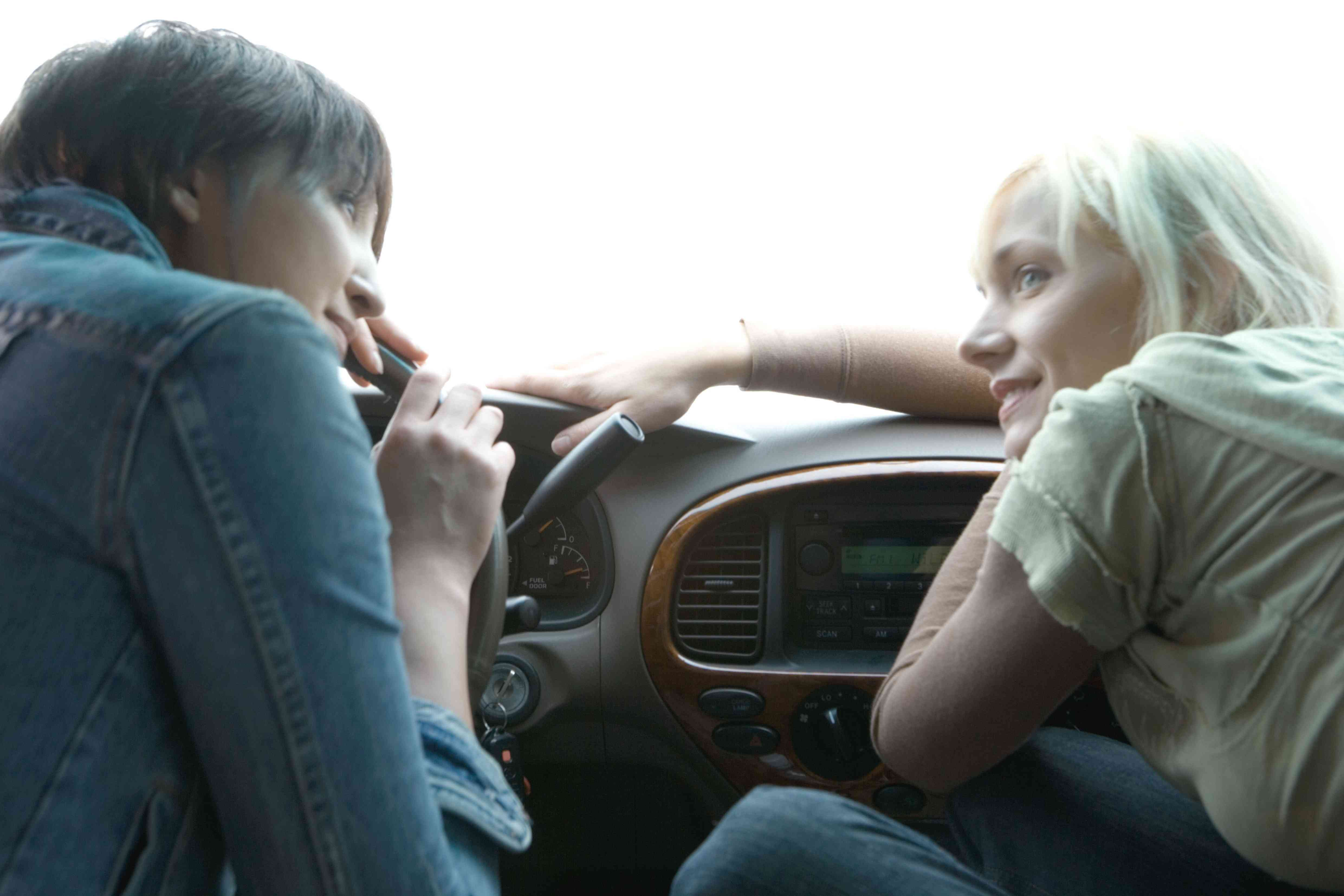 Two people listening to radio in the car