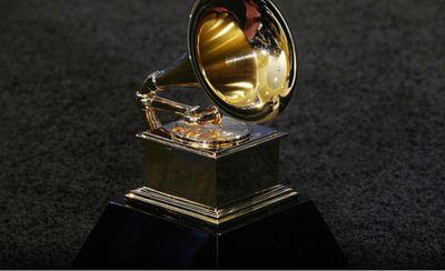 Grammy statuette against a dark background