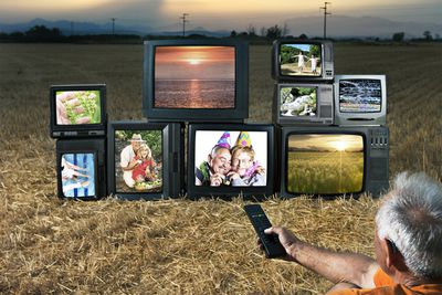 Person watching analog TVs