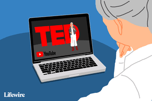 Person sitting at their computer, whose screen shows a TED Talk in progress on YouTube