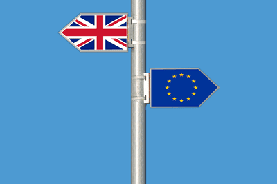 Picture of the UK flag and flag of Europe on a pole