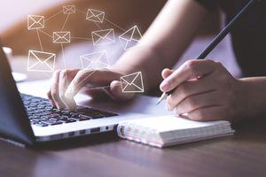 Business woman using Laptop send e- mail