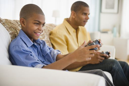Father and son playing Castlevania video game