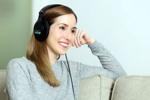 A woman listening to headphones.