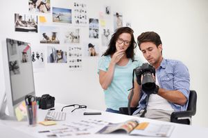 Photographers at desk