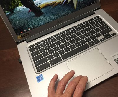 Someone using the touchpad on a Chromebook.