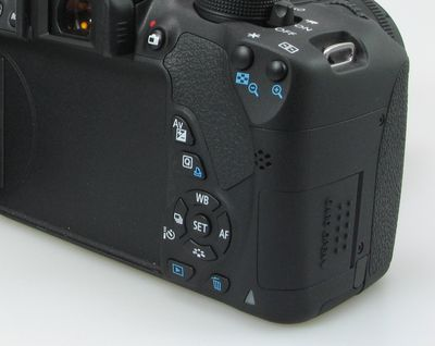 Back view of a DSLR against white background.