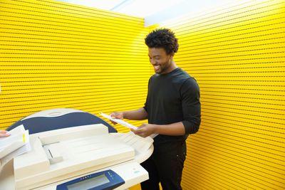 A man using a photocopy machine
