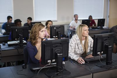 People in classroom on computer