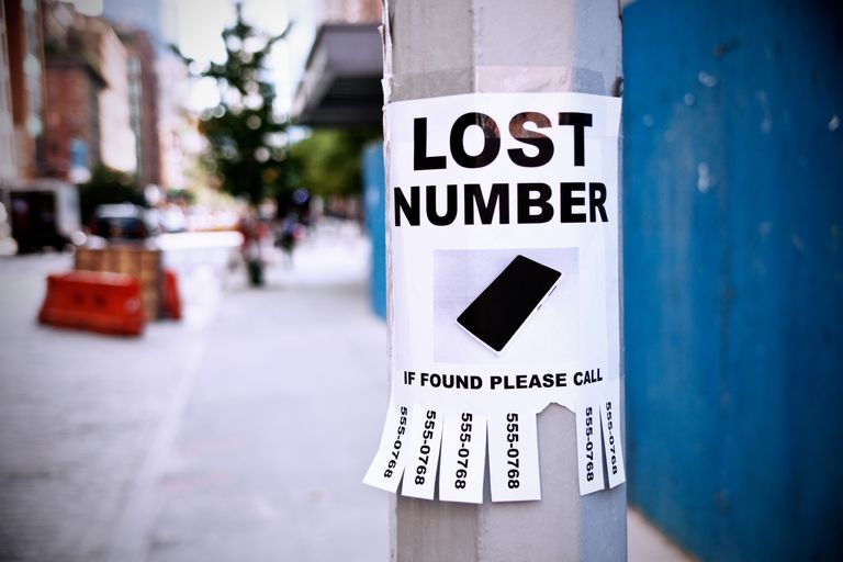 Photo of a LOST NUMBER sign on a street pole