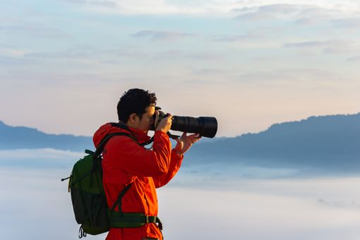 Man with camera and telephoto lens