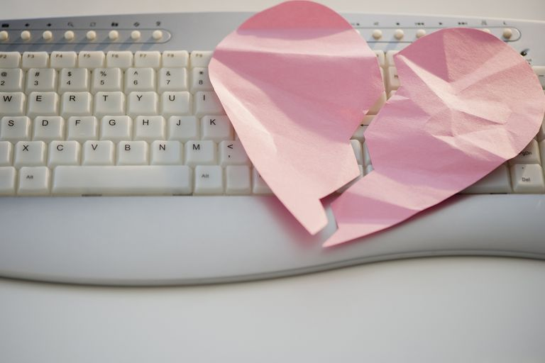 Close up of broken heart on computer keyboard