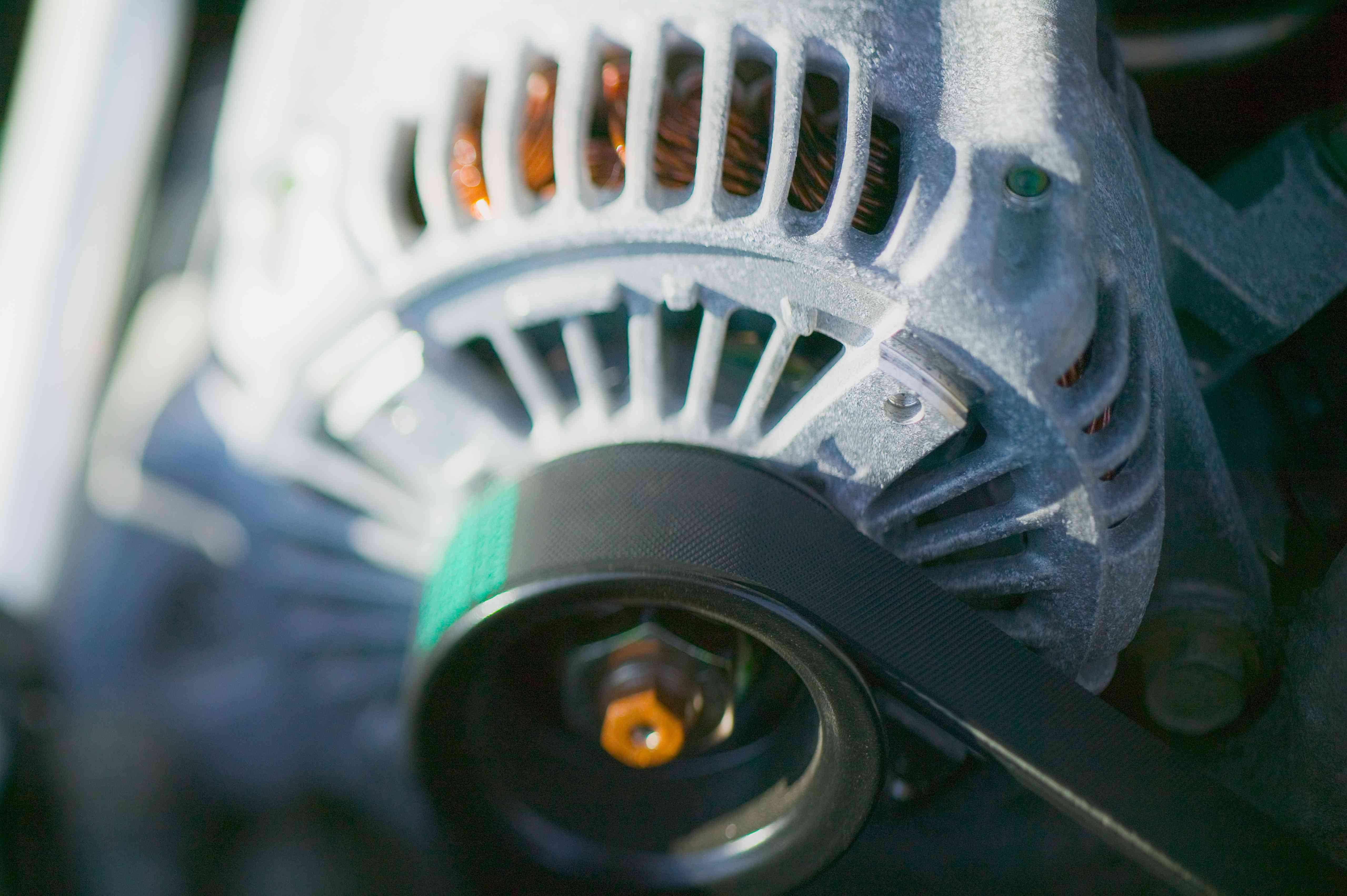 Closeup of car alternator.