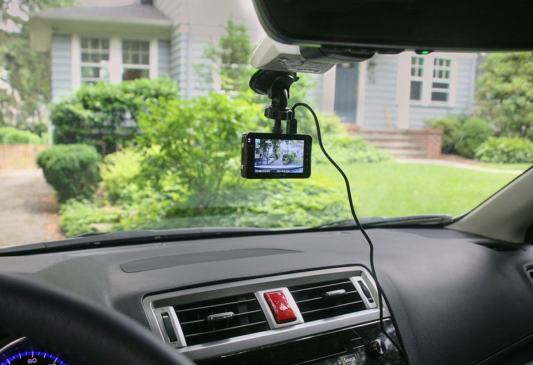 Dash cam on car parked in driveway