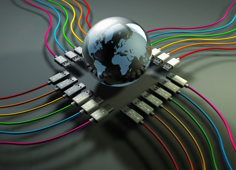 Globe at center of multicolored usb cables