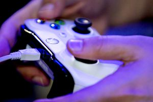 Hands holding and using Xbox One Controller