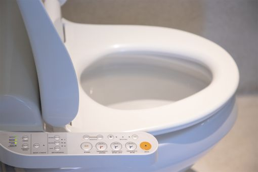 Photo of smart toilet with controls on the side.