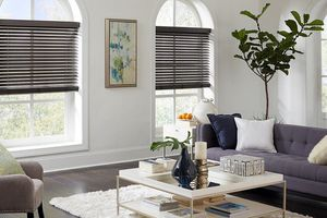 Pair of living room windows with smart blinds half opened