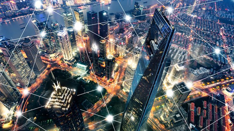 Decentralized network over a city at night.