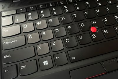 A photo of a Lenovo laptop keyboard showing the Function and Spacebar keys