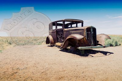 Derelict car on the site of the old Route 66 in the Petrified Forest National Park Arizona USA
