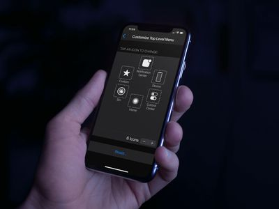 Closeup of someone customizing the AssistiveTouch buttons on an iPhone.