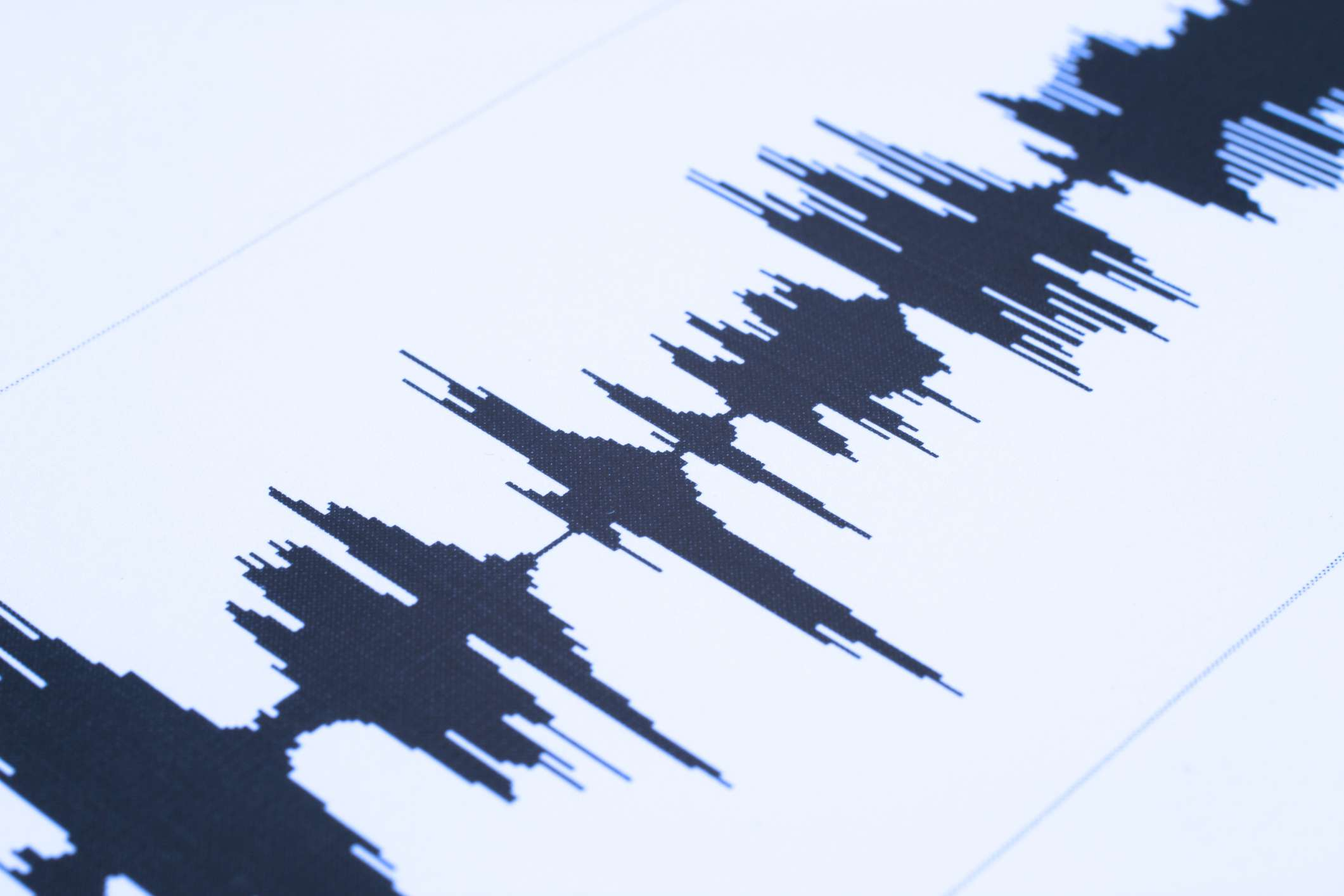 A photograph of a soundwave depicted on a screen in an audio production program