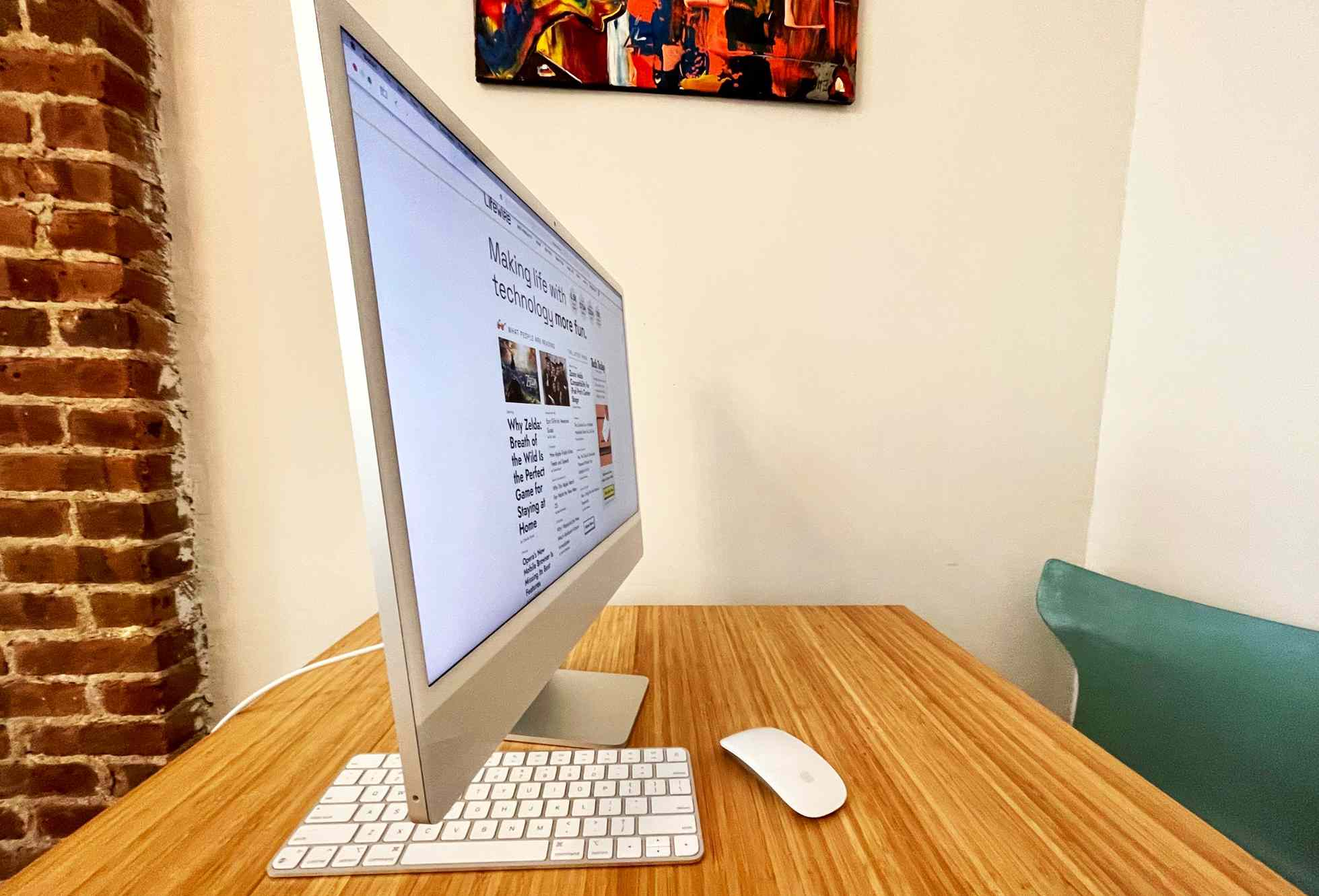 The M1 iMac side view showing how thin the computer is.
