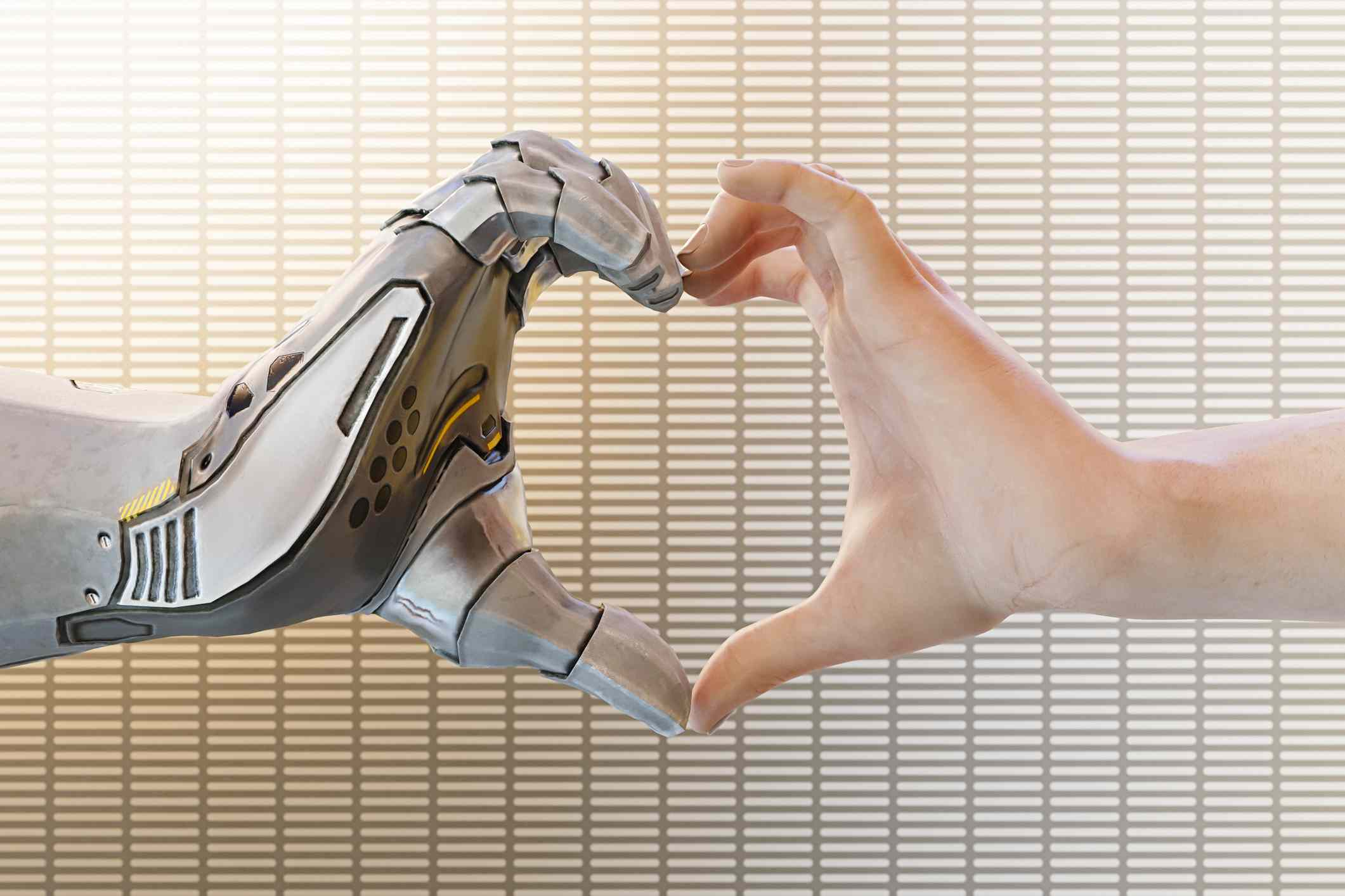 A robot hand and a human hand forming the shape of a heart.
