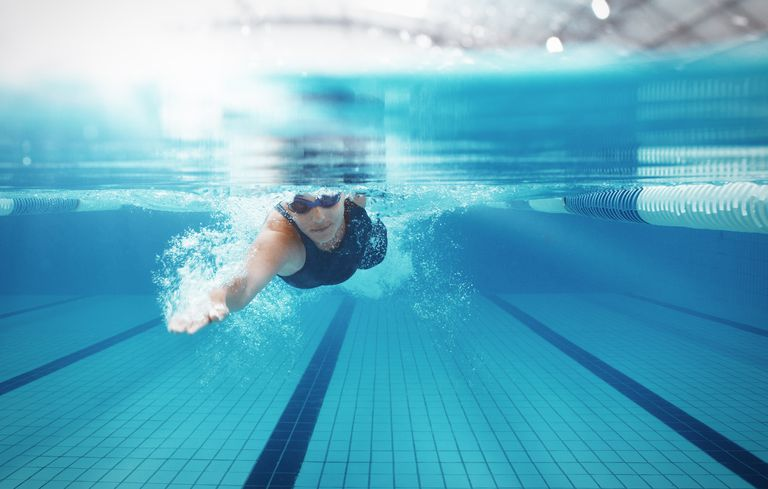 Swimmer swimming in a lap pool