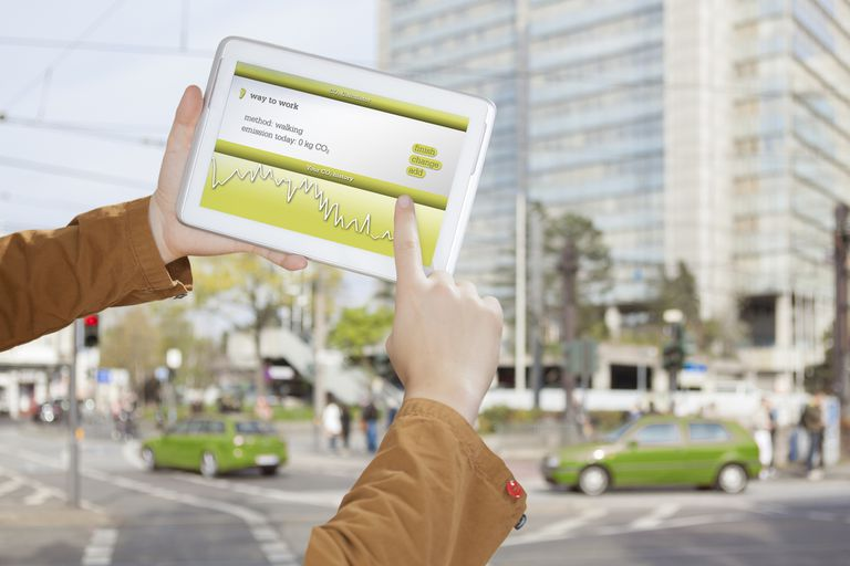 A mobile app being used on a tablet outdoors