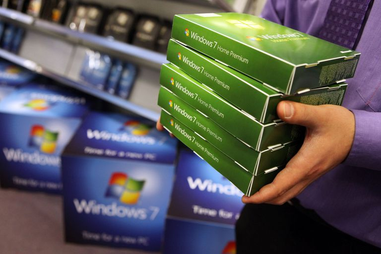 Man carrying retail boxes of Windows 7